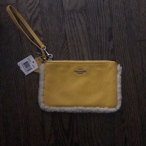 Coach Bags - Yellow and fuzzy coach wristlet